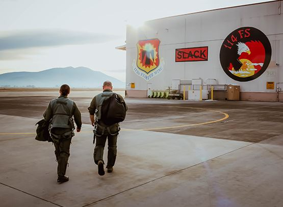 two pilots walking to there base
